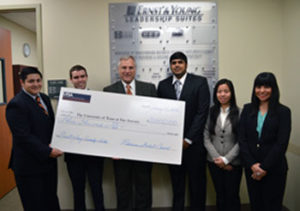 Business Student Council members present check to Dean Sanders