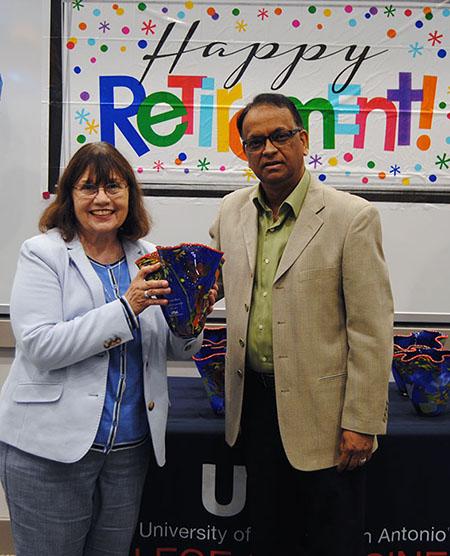 Martha Fasci receives a gift from Chair Sharad Asthana.