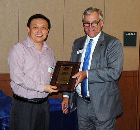 Harrison Liu receiving his award from Dean Gerry Sanders.