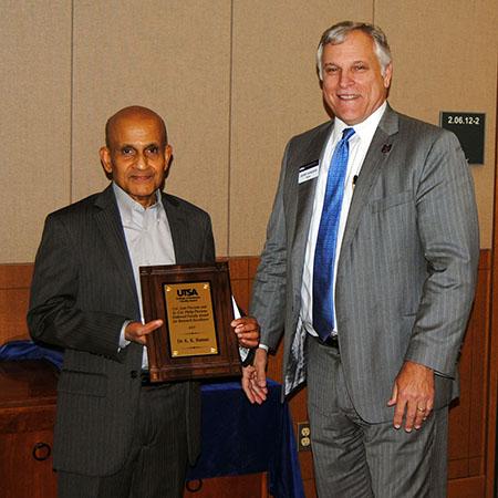 K. K. Raman receiving his award from Dean Gerry Sanders.