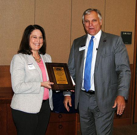 Nicole Beebe receiving her award from Dean Gerry Sanders.