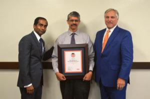 Rao receiving award